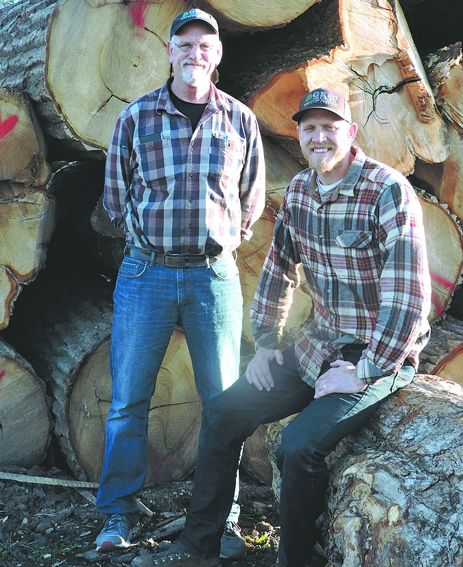 Chris Grau, left, and his son, Pat, are the second and third generation foresters of a sawmill established by Chris' father, Bob, in 1948. The Graus help landowners make solid decisions about harvesting their woodlands.
