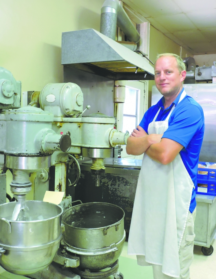 Christopher Reimer mixes a batch of glaze for doughnuts. Christopher is the third generation to run Pedretti's Bakery.