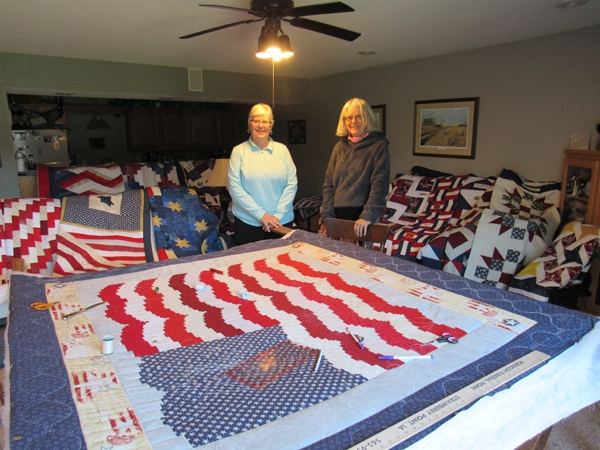 """By Caroline RosackerThe Quilts of Valor Foundation is a national organization founded in 2003 by """"Blue Star"""" mom Catherine Roberts. The idea of comforting veterans with quilts came to her while her son was deployed in Iraq as a gunner sitting atop a Humvee. Her sense of panic 24..."""