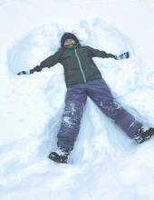 Makenzie Thorson making a snow angel